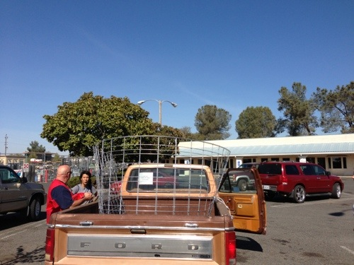We learned how to make cattle panels fit in the back of a truck.
