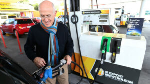 AUCKLAND, NEW ZEALAND - JULY 08: Bob Burgess fills his car with DB Export Brewtroleum, a biofuel made with the yeast left-over from brewing beer on July 8, 2015 at the Gull Station in Kingsland, Auckland, New Zealand. DB Export claims to be the first company to make biofuel derived from beer and is now selling the fuel at 60 petrol stations across the North Island. (Photo by Fiona Goodall/Getty Images)