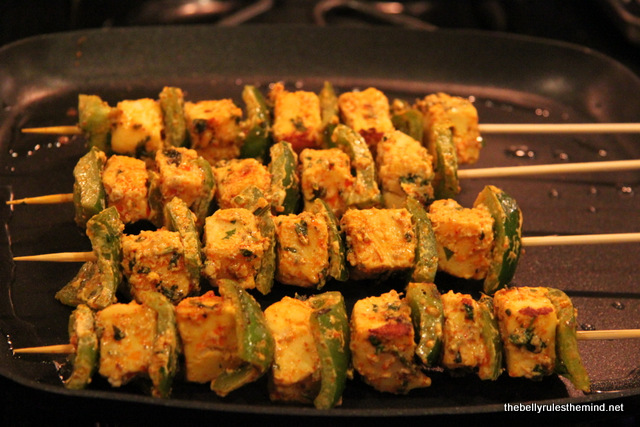 Cooking Paneer Tikka skewers on Stove Top