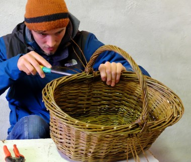 Ben finishing an oval basket.