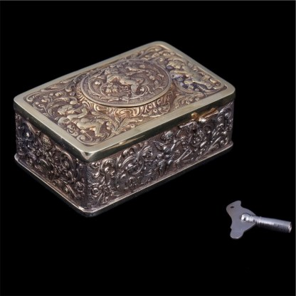 Antique music box with a singing bird
