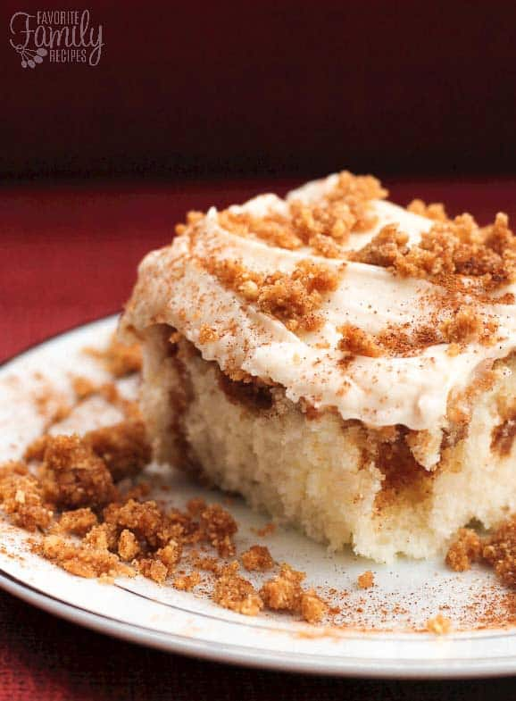 Cinnamon Swirl Cake is like a cinnamon roll in cake form. A cinnamon crumble is swirled through a white cake with cream cheese frosting on top.