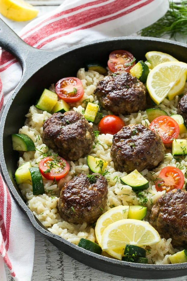 This Recipe for One Pot Greek Meatballs with Lemon Dill Rice includes a savory Greek spiced beef meatballs. creamy arborio rice and vegetables, all cooked together in a single pot!