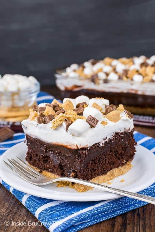 A graham cracker crust, chocolate pudding, and a marshmallow topping make this Chocolate S'mores Pudding Cake the perfect summer dessert for picnics and parties.
