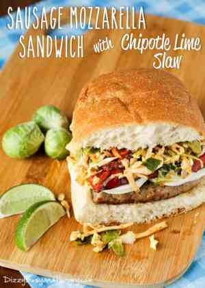 This Sausage Mozzarella Sandwich with Chipotle Lime Slaw has a tangy, crunchy slaw, roasted red peppers, creamy mozzarella and Italian Sausage. YUM! | Featured on The Best Blog Recipes