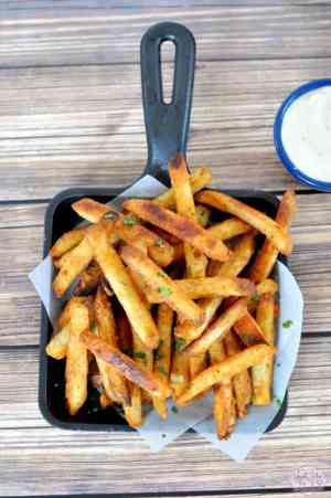 CRAB FRIES | This is an easy side dish with a secret ingredient that turns regular potatoes into something amazing! Featured on www.thebestblogrecipes.com