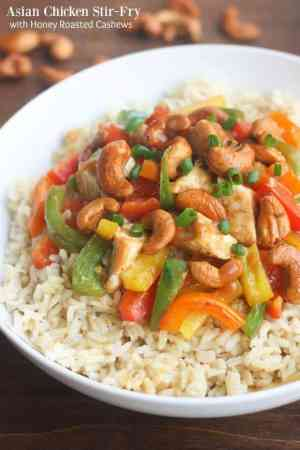 SKINNY ASIAN CHICKEN STIR-FRY W/ HONEY ROASTED CASHEWS -- is a stir-fry that is packed with flavor, veggies, and protein and is super easy to make. | Featured on www.thebestblogrecipes.com