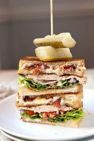 GRILLED CHEESE CLUB SANDWICH -- with layers of turkey, bacon, melty cheese and all of our other favorite club ingredients! | Featured on www.thebestblogrecipes.com