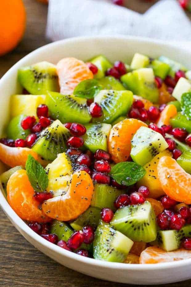 This Winter Fruit Salad Recipe is a colorful variety of fresh fruit tossed in a light honey poppy seed dressing. The perfect side dish for brunch or a holiday meal!