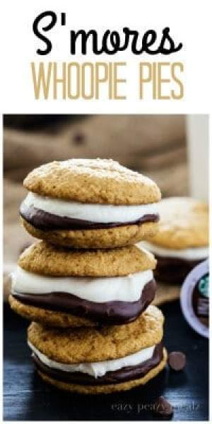 S'mores Whoopie Pies -- A graham cracker cake cookie, chocolate ganache, and a tasty marshmallow buttercream!