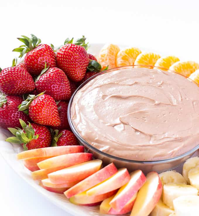It only takes 5 minutes and a handful of ingredients to whip up this chocolate almond butter fruit dip. The base of this dip is Greek yogurt and almond butter, making it as healthy as it is yummy.