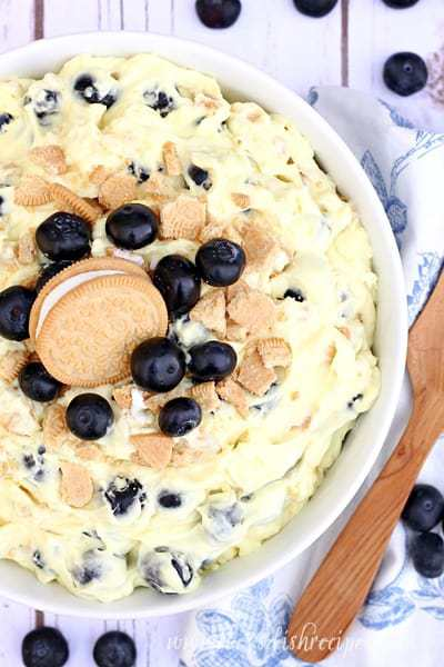Everybody needs a good potluck salad recipe in their collection. You know, the fluffy kind made with pudding and whipped cream. And you won't have any leftovers when you bring this Golden Lemon Blueberry Cheesecake Salad to your n
