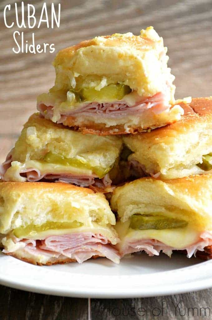 hese Cuban sliders are loaded with ham, swiss cheese, and dill pickles, topped with a dijon mustard onion spread! Super easy to make and definitely a crowd pleaser!!