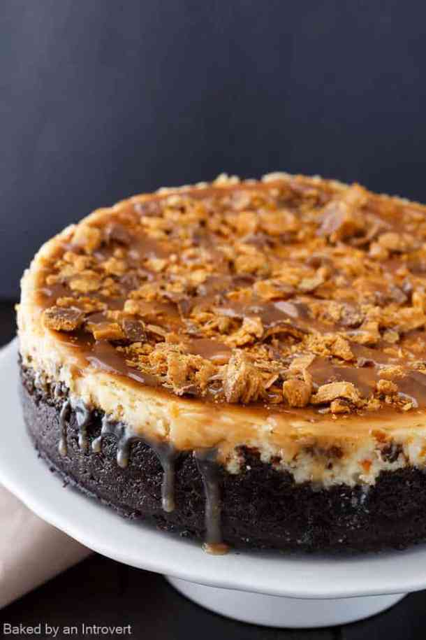Butterfinger Cheesecake with Caramel Drizzle -- Part of The Best Butterfinger Recipes