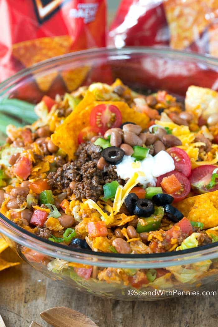 Seasoned ground beef, fresh lettuce, pinto beans, veggies and of course Doritos all sauced up with a zingy dressing make this an exciting change to your daily menu!