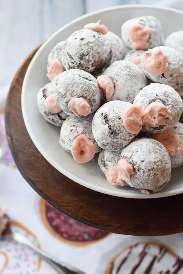 Need a sweet treat for your honey this Valentine's Day? You'll win big if you make these Chocolate Donut Holes with Pomegranate Cream Filling. They are sweet, fluffy and filled with creamy goodness. {gluten free}