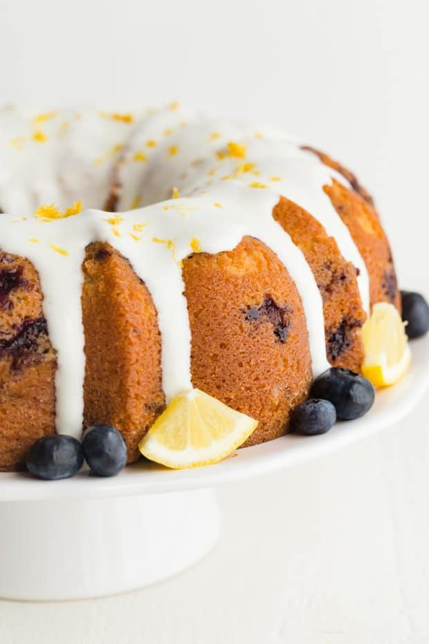 Lemon Blueberry Bundt Cake made completely from scratch has taken the classic lemon bundt cake and speckled it with fresh blueberries then topped the whole cake off with lemon cream cheese glaze. Perfect for spring get-togethers.