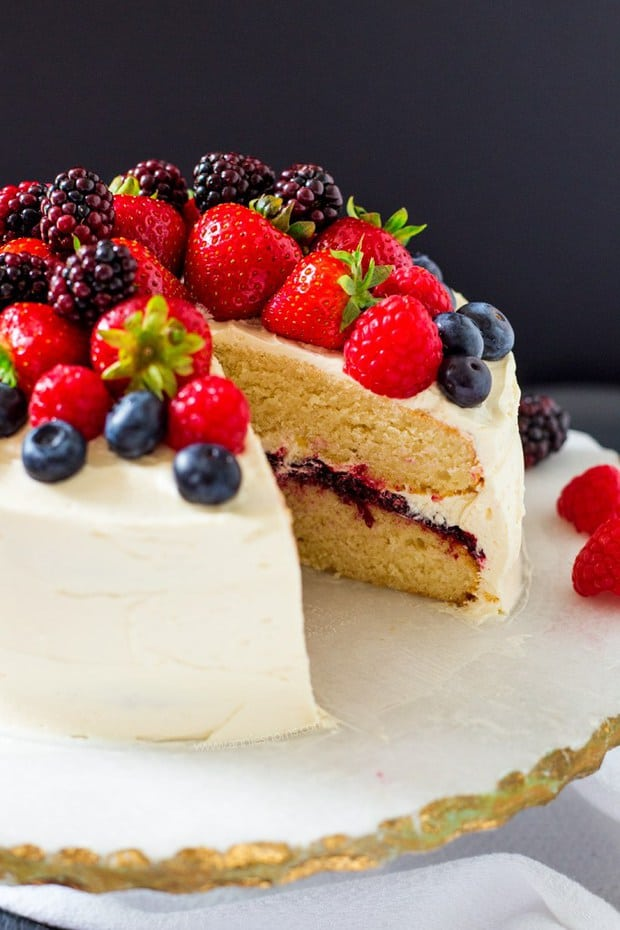 his Summer Berry Layer Cake is the ultimate cake for the berry lovers in your life with layers of vanilla cake, homemade berry jam and a myriad of fresh berries on top.