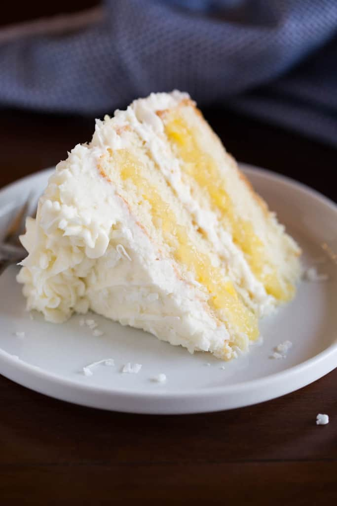 This is, dare I say it, the most AMAZING Coconut Cake to grace the earth. Layers of tender, moist coconut cake, fresh pineapple filling, and whipped coconut cream cheese frosting that all pair together perfectly. The final product is somewhat of a masterpiece, and could be one of my favorite cakes of all time!