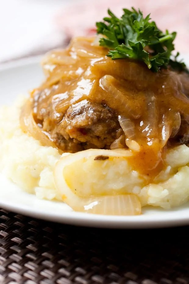 A real recipe for homemade Salisbury steak using no soup mixes. Seasoned beef patties seared and braised in a rich onion gravy. The best comfort food!