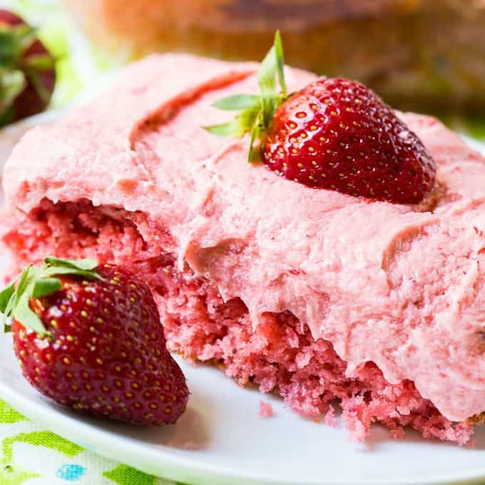Strawberry Sheet Cake with fresh Strawberry Buttercream Frosting has so much strawberry flavor and it is a cinch to make with a box of white cake mix. The cake itself gets its strawberry flavor from fresh strawberry puree and a box of strawberry gelatin.