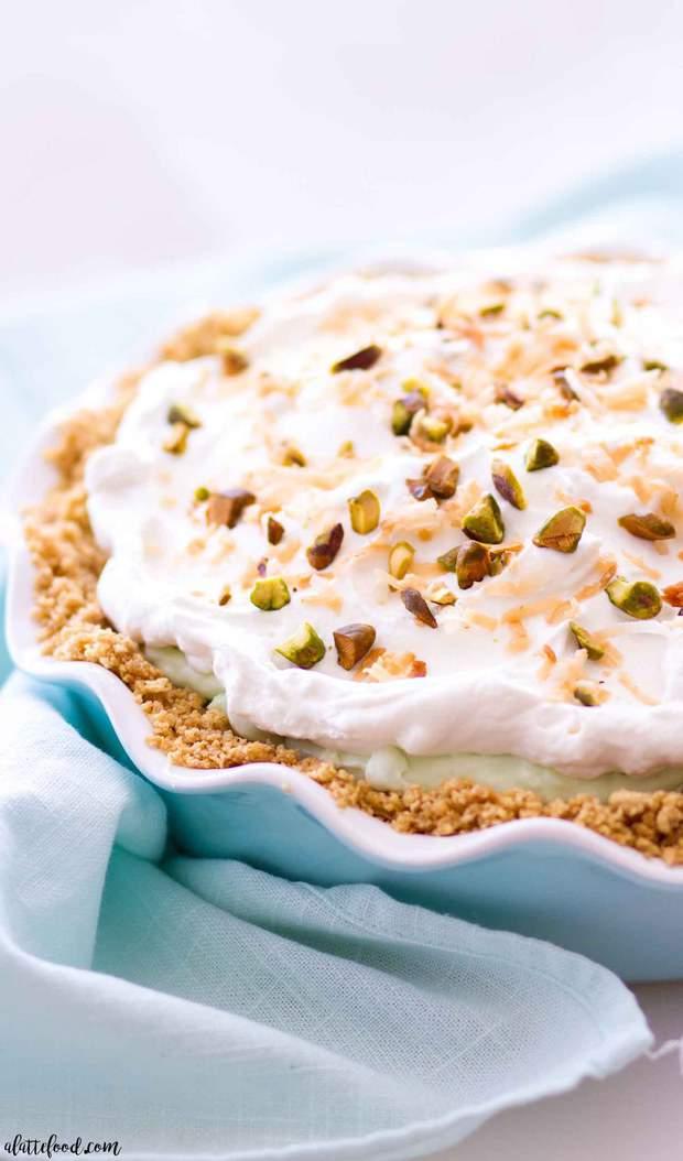 This homemade no bake pistachio pudding cream pie is layers of graham cracker crust, pistachio pudding cream, and whipped cream!