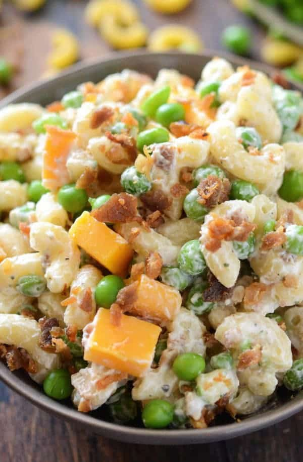 A quick, easy & creamy pasta salad with cheddar cheese, bacon, peas & ranch seasoning all tossed together for a great potluck dish!