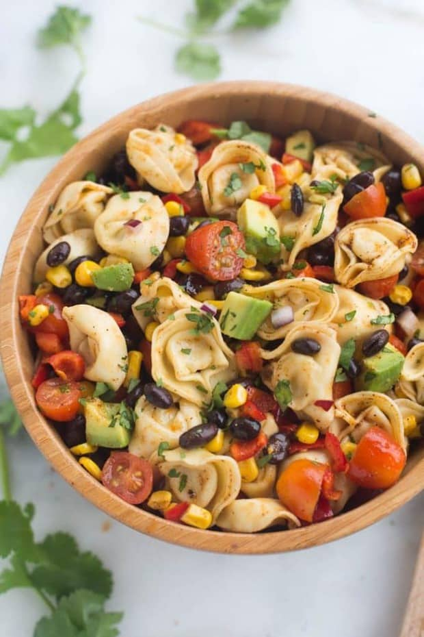 A fresh and easy southwest tortellini pasta salad that can be made in less than 30 minutes! It's loaded with veggies and protein and coated in a deliciously simple and healthy southwest dressing.