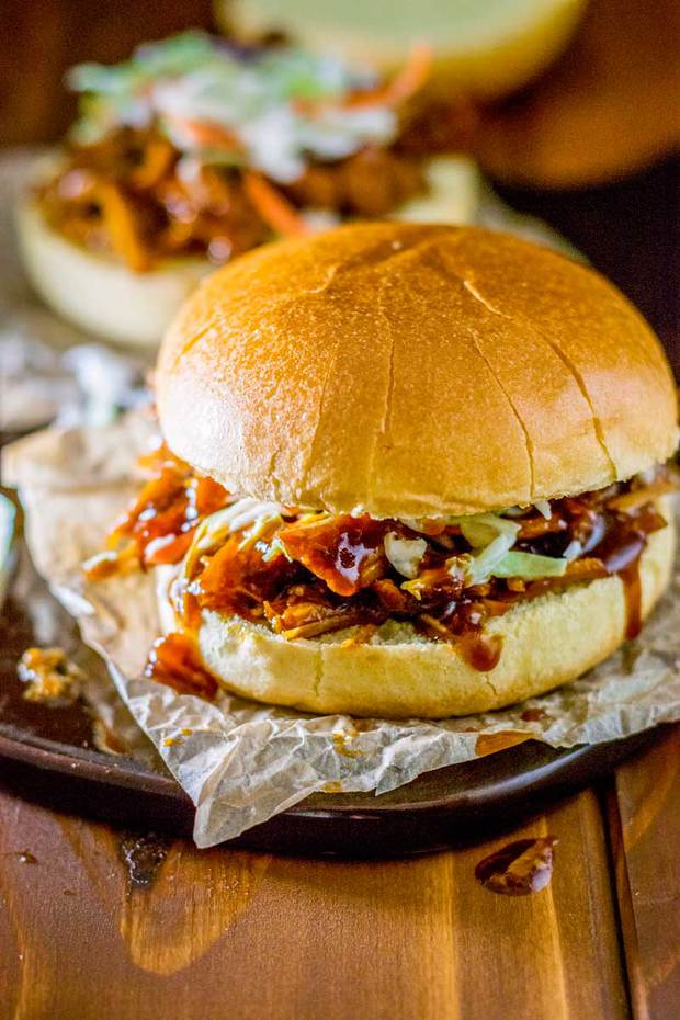 Transform your favorite BBQ sauce into deliciously sweet crock pot pulled pork that goes perfectly with just about any sandwich or taco topping
