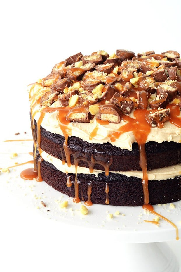 Calling all Twix lovers! This Twix Caramel Chocolate Cake is the cake of all cakes. We are talking two layers of soft and fluffy chocolate cake with a silky smooth caramel frosting, all topped with an avalanche of chopped Twix bars, crushed shortbread cookies and drippy salted caramel sauce.