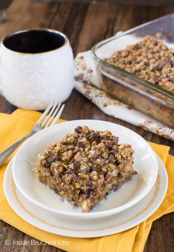 A crunchy topping on this Chocolate Chip Banana Streusel Baked Oatmeal will have you ready for breakfast in the morning. Enjoy a warm square with milk and drizzles of honey.