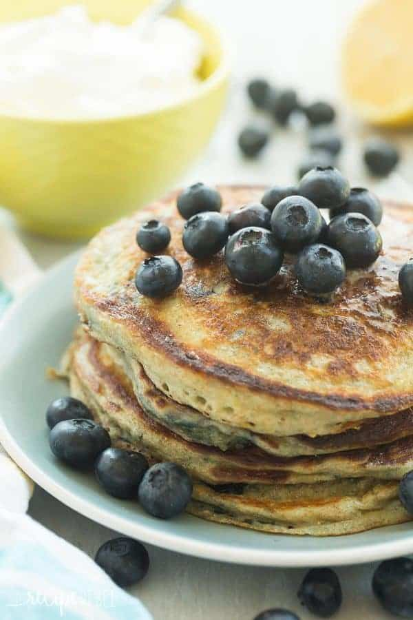 These Lemon Blueberry Greek Yogurt Pancakes are light, fluffy and made healthier with whole wheat flour! They're loaded with blueberries and pack a punch of citrus flavor!