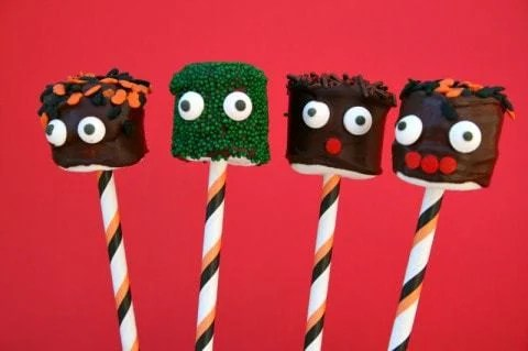 Marshmallows on a stick become Halloween monster heads with a little chocolate and some sprinkles — easy to do and they make a big impression!