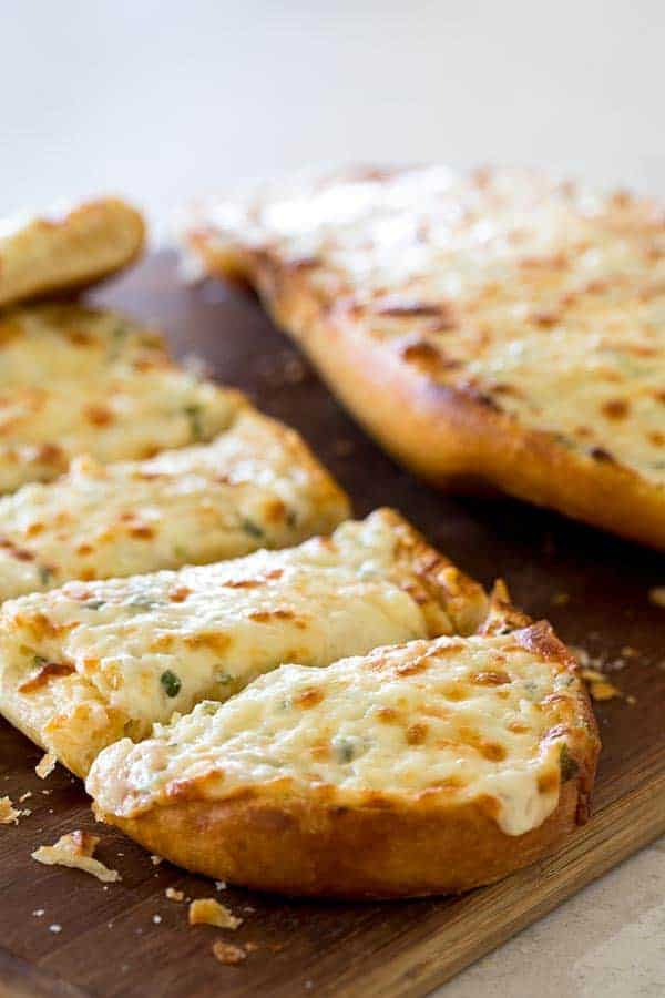 Black Angus Cheesy Garlic Bread is perfect to serve with your favorite Italian meal or that steak you're grilling. It's ooey, gooey, rich and buttery, and crisp and crunchy.
