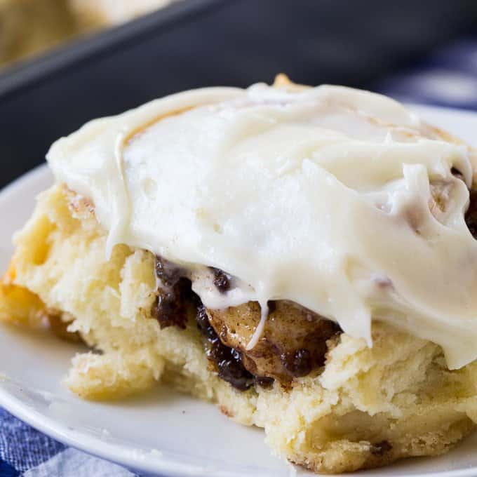 Homemade Sausage Cinamon Rolls are the perfect combination of sweet and savory. A mixture of ground pork breakfast sausage and cinnamon is rolled up in a soft and tender homemade cinnamon roll dough. Once baked they are slathered with an ultra thick layer of cream cheese glaze to add a whole bunch of sweetness and a little bit of tang!