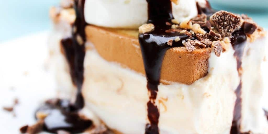 Hot Fudge Caramel Ice Cream Cake is a layered cake made with pound cake and caramel ice cream, and topped with the best hot fudge sauce you will ever have. It's then finished off with whipped cream & toffee.