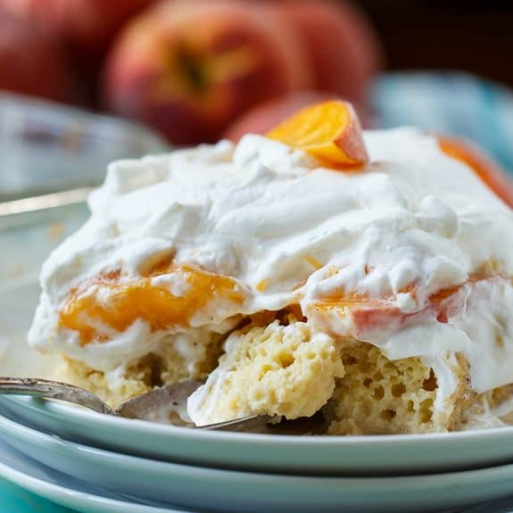 Peach Bourbon Tres Leches Cake makes a wonderful make ahead dessert for a summer get together. It is cool and creamy and fabulously rich with a layer of sliced fresh peaches and a little bourbon to add another flavor dimension.