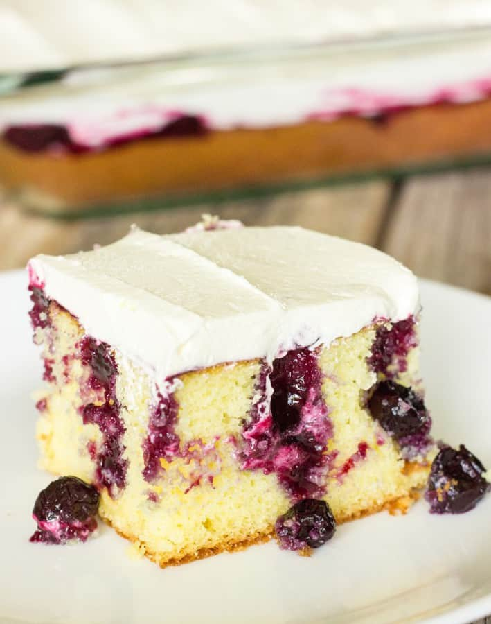 This blueberry lemon poke cake is to die for! It's a lemon cake with holes poked in it.Lemon blueberry sauce is drizzled on top of the cakeso that the sauce and blueberries get down into the holes. Then, it's topped off with a frosting made of lemon curd and cool whip. Amazing!