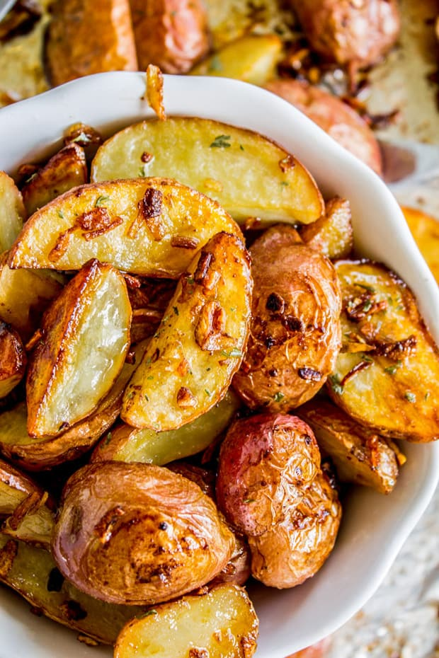 Potatoes that roast in the oven and get a crispy edge and tender center. They have such a great parmesan garlic flavor and will be the perfect side!