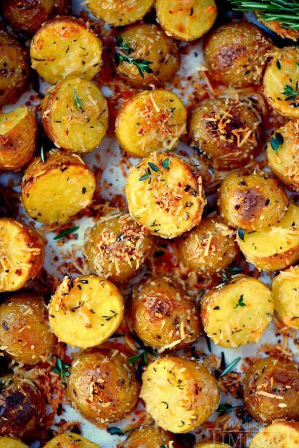 Oven Roasted Herb and Garlic Parmesan Potatoes -- part of Loaded Potato Recipes that make the PERFECT Dinner Side Dish
