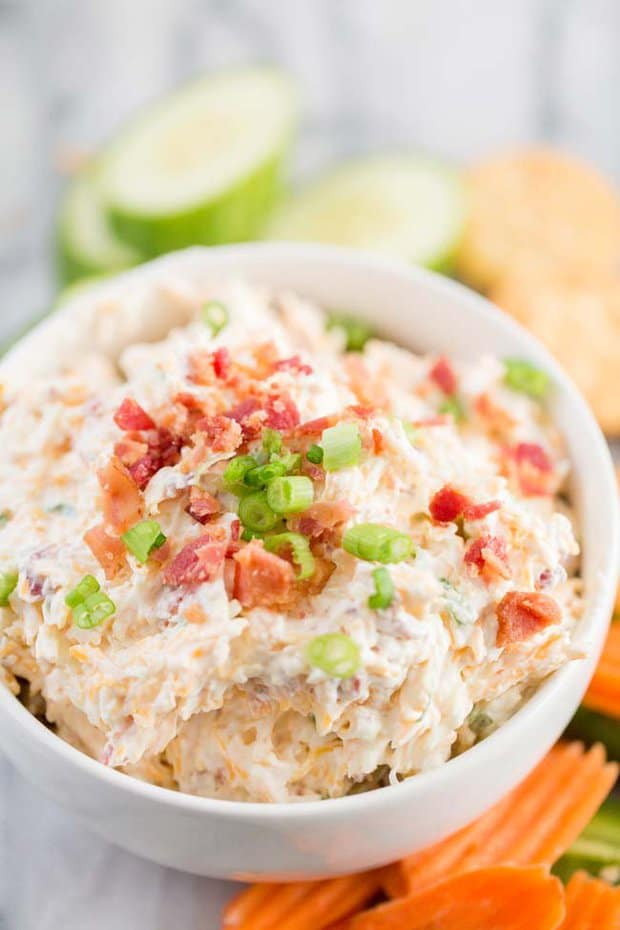 If you need a delicious and easy appetizer to make for your friends and family, then this Million Dollar Cream Cheese and Garlic Dip is the recipe for you! All you need is 5 minutes and a few ingredients to make something that everyone will LOVE!Find the kids and ask them to help... it's so simple they could even make this recipe for you! No cooking involved. Just dump, stir and go.