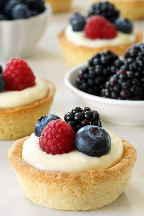 Berry Cookie Cups have a sugar cookie crust and a delicious white chocolate cream cheese filling. Recipe contains a gluten-free option.