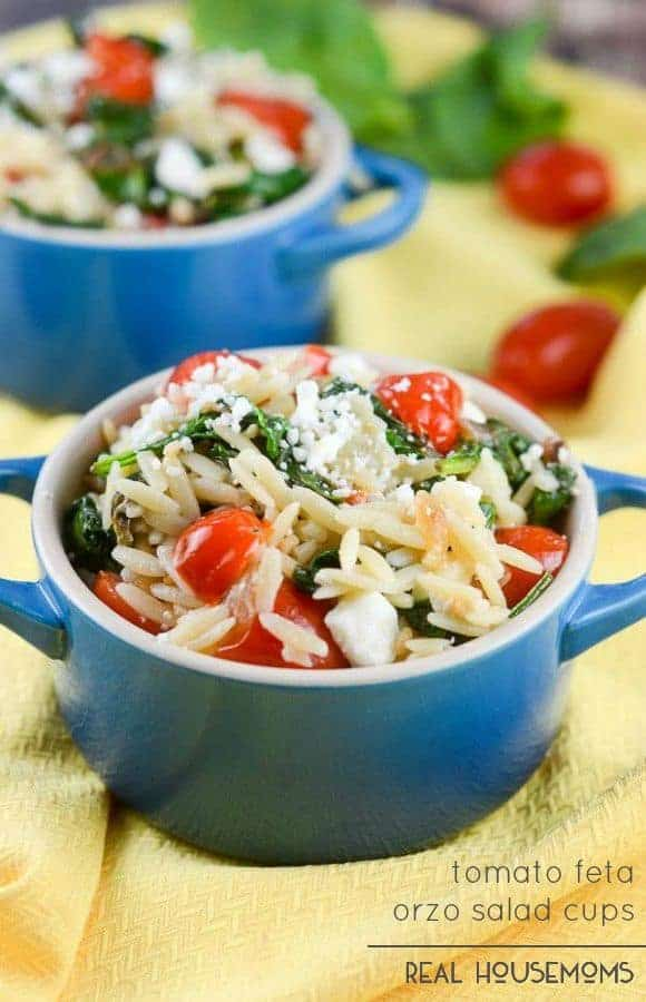 Tomato Feta Orzo Salad Cups are cups with orzo pasta with tomatoes, spinach, garlic, and feta cheese dressed in an Italian vinaigrette. It makes a wonderful pasta salad with a Mediterranean flair.