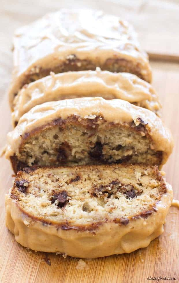 Chocolate Chip Banana Bread with Peanut Butter Icing is absolutely delicious! The peanut butter glaze and the melty chocolate chips make this Chocolate Chip Banana Bread recipe absolutely to die for! You're sure to love this quick and easy snack or dessert!