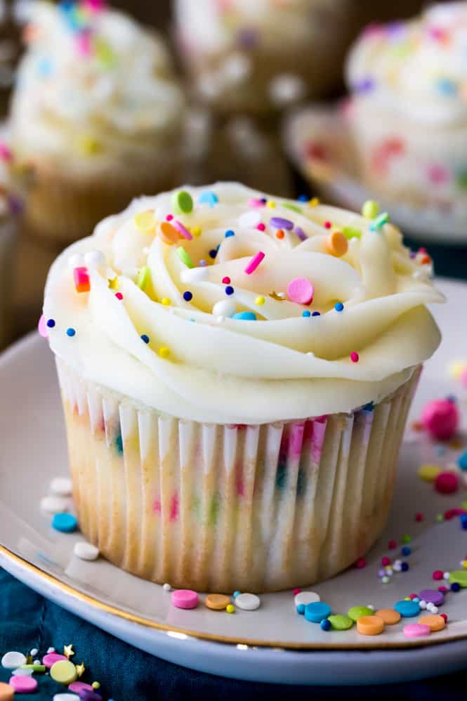 Soft, light, and fluffy, these sweet confetti cupcakes are modified from my popular funfetti cake recipe! These cupcakes are packed full of colorful sprinkles and made with a simple white cake base, then topped off with a sweet vanilla buttercream (and, of course, sprinkles!).