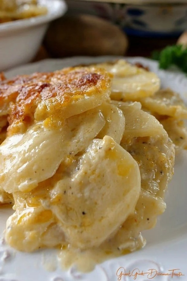 Cheesy Garlic Scalloped Potatoes -- part of Loaded Potato Recipes that make the PERFECT Dinner Side Dish