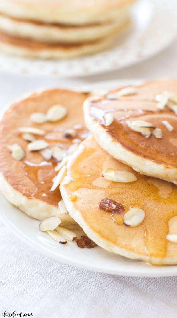 This Greek Yogurt Honey Almond Pancake recipe is so simple! These fluffy homemade pancakes are packed with protein and are free from refined sugar! You won't feel guilty about this breakfast!