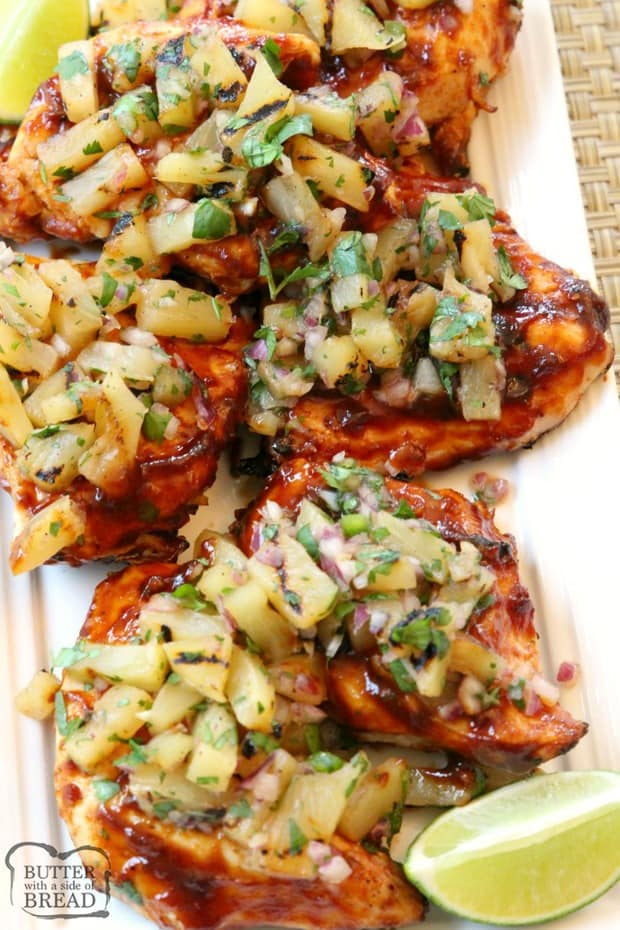 Grilled BBQ Chicken with Pineapple Salsa is made by smothering grilled chicken with thick & flavorful bbq sauce then topping it with a delicious pineapple salsa made with lime and jalapeno. Perfect for weeknight dinners or weekend get-togethers, the pineapple salsa pairs perfectly with the tangy grilled barbecue chicken.