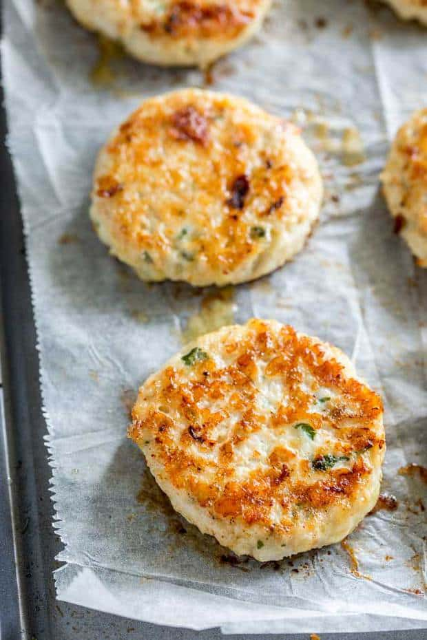 Everyone will love these Cauliflower Cheese Chicken Fritters. Not only do they make great party finger food they they are perfect for a mid-week family meal. Light, crispy, and packed with cauliflower, these are always demolished.