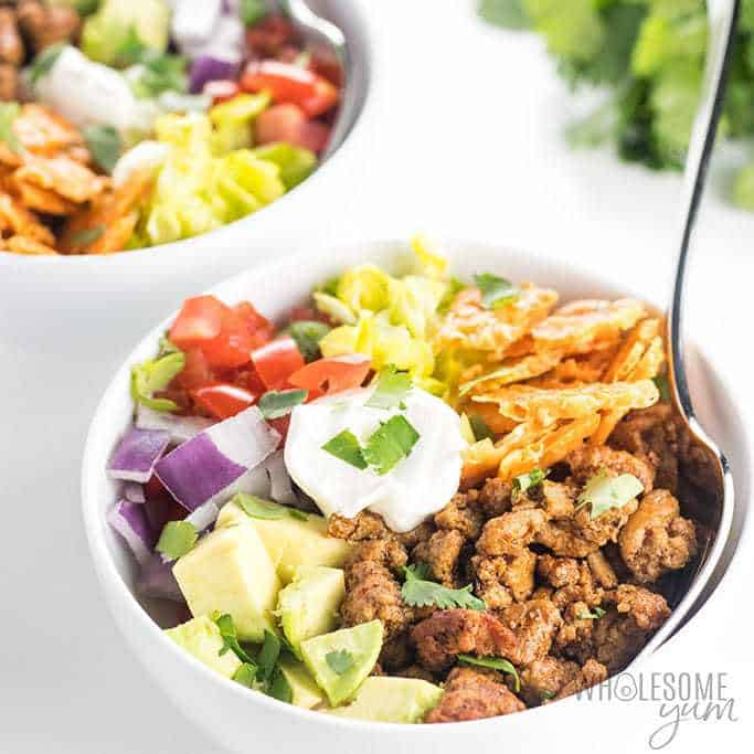 These homemade taco bowls are an EASY recipe for how to make walking tacos. They are delicious and healthy! Learn how to make a turkey taco bowl for 4-6 people, or even walking tacos for a crowd of 50 or 100 people.